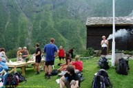 Hikers on the world heritage tour are served small pancakes, jam and some history about Drægo.
