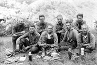 One work team at Høga in the valley of Flåmsdalen takes a break. The back row from left to right: Bernhard Haglund, Gunnar Jansen, Ola Hauge, Olav Haugen. The front row from left to right: Andreas J. Flåm, Georg Haglund, Arthur Johansen and Torstein H. Flåm.