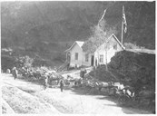 The road down from Myrdal created a new kind of industry - tourism. Small hotels and cafés were established on several locations in the valley of Flåmsdalen. This picture shows Berekvam café where both beer and wine were served. The café remained open until 1940. The café marked the midway point between Fretheim and Myrdal and was a regular stop for the traffic up and down the valley. After 1940, tourists took the train and had no longer any need to make a stop at Berekvam.