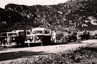 When the road across the Sognefjell mountain pass was opened for regular traffic in 1939, this led to increased income for the car companies. Even during the Second World War, cars were filled to capacity across the mountain. Frequently extra cars had to be used. There could be as many as 50 passengers up to Turtagrø. There were three scheduled tours across the Sognefjell mountain pass every week. The passengers were mostly mountain hikers from Bergen or eastern Norway. The picture shows one of the buses on a scheduled tour across Sognefjellet in 1939. In the background we can see the peaks of Skagastølstindane.