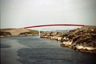 The red-painted Mjåsund bridge between Sandøy and Mjømna. The bridge was officially opened by the county council chairman Sjur Hopperstad on 9 July 1993. The work started in October 1992.