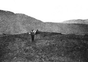 The hill of Bergahaugen at Eggja, where the runic stone was found in 1917. The two men on the picture are probably those who found the stone, Nils J. Eggum and his son Johannes.