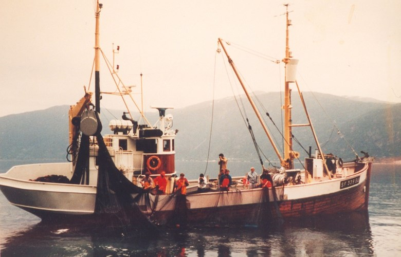 "The M/K ""Saltskaaren"" was one of the vessels which held out the longest in the tuna fisheries. After 35 seasons, she caught her last six tuna in 1986. This beautiful 63-foot vessel was operated by the experienced Anton and Arne Saltskår and was an exceptionally lucky tuna fisher. In 1974, they had the largest catch of the season, 182 tuna. This picture was taken during the brisling fisheries, in which the ""Saltskaaren"" was almost legendary.<br /> Enthusiasts took over the vessel in the end, in order to fix her up and preserve her for posterity. Despite much effort, they have thus far not been able to realise the project."