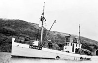 "The 60-foot ""Fremad II"" with a 50 HP Wichman engine, belonged in the bay. Trygve Hop was her skipper both during the winter herring and the tuna fisheries. In this picture there is a tuna seine on the stern. The look-out barrel is manned, and on the roof of the wheelhouse there is a look-out place as well. After an extensive rebuilding, the vessel was sold to Rogaland in the 1960s. From there she continued to take part in the tuna fisheries, with the same name.<br /> The ""Fremad II"" transported refugees and resistance people to England during the Second World War."