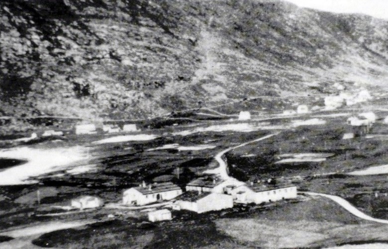"The prison camp at Ervik seen from Eggjane. The houses in the foreground were used for the prisoners. The other houses belonged to ""Organization Todt"" and were used as quarters for hired workers, office barracks, and a canteen with Norwegian canteen staff."