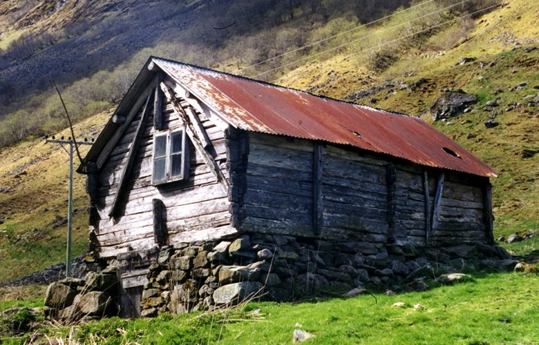 An old spring farm building at Melhus. This farm is located two kilometres southwest of Undredal, and in its heyday Melhus had 12-14 farm buildings.