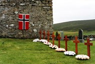 Eight war graves at the Ballista church on the island of Unst. One of them is Kristoffer Lutenthun's grave. The picture was taken on 11 August 1994, on the day a memorial plaque on the church wall was unveiled. The Norwegian flag covers the plaque before the unveiling ceremony.