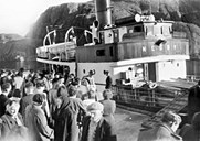 "The turnout was often large and good-natured at the quay of Lågøy, but not quite like this: after the guests have celebrated the wedding of Maria and Arvid Athammar at Lågøy for three days, some of them are going to Bergen on the M/B ""Nesøy"". The Lågøy terminal was built in 1926, and has been improved since then."
