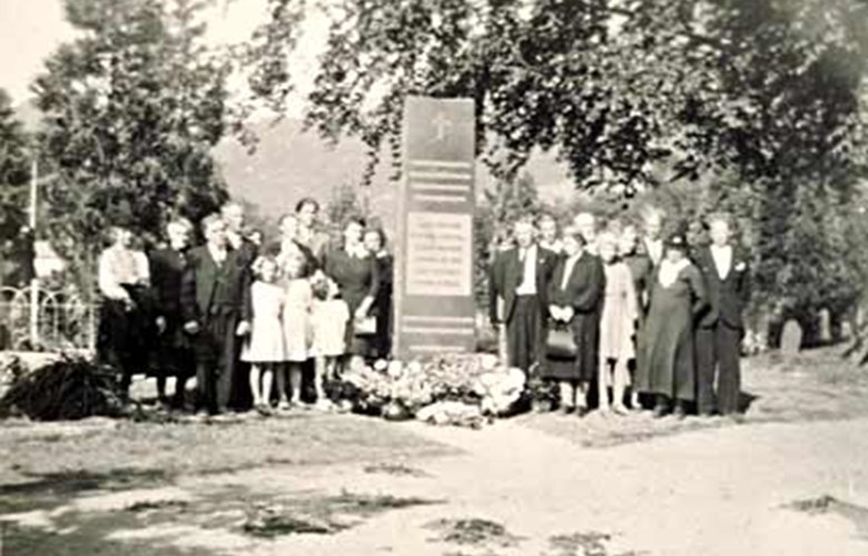 The memorial stone was erected in 1947 and unveiled on 29 August. Families of several of the fallen men have assembled at the stone.