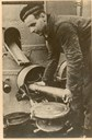 "Arthur Torheim photographed while loading a gun onboard the submarine ""Ula""."