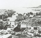 An older picture of Rognaldsvåg with the harbour and some houses. In the period of the rich winter herring fisheries in the 1850s and 1860s, the place was teeming with hectic activities.