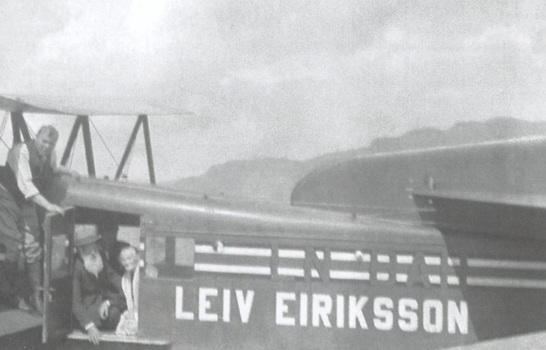 "Thor Solberg has landed with ""Leiv Eiriksson"" off his boathouse at Solberg, where he takes his parents, Gunhild and Simon Solberg, on their very first flight. The pilot himself stands in his white shirtsleeves on the wing, holding the door open for them."